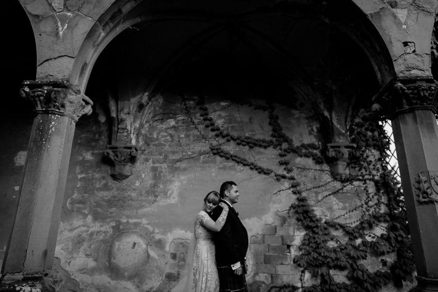 bride and groom intimate pose vincigliata castle black and white