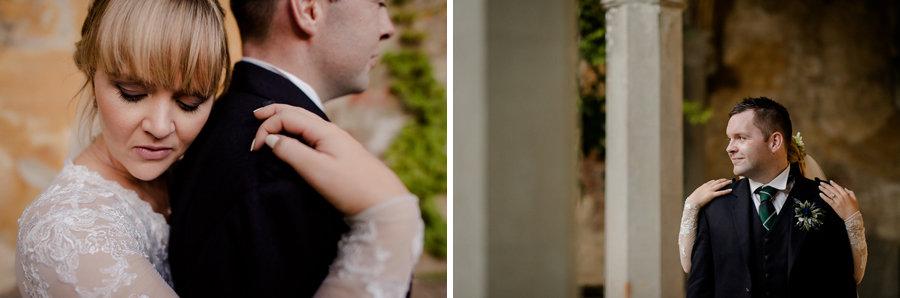 Bride and groom hug in vincigliata castle florence