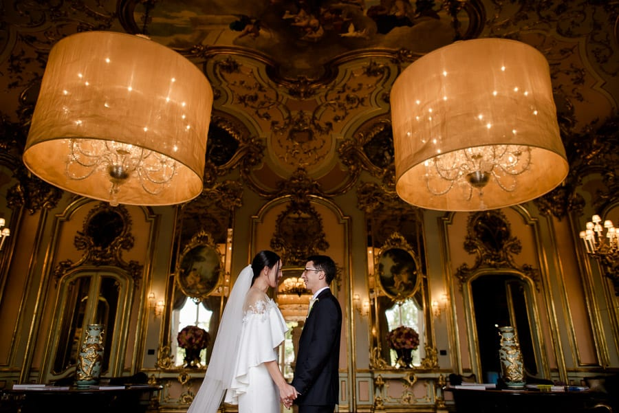 Bride and groom inside the mirror room