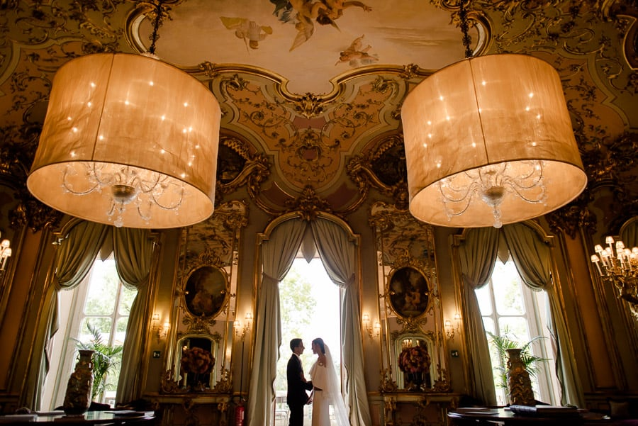 Bride and groom in the mirror room