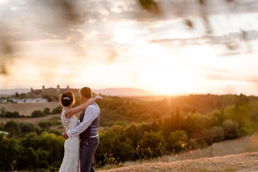 Tuscany Wedding Styling Ideas and Inspiration bride and groom to the sunset in a tuscany landscape