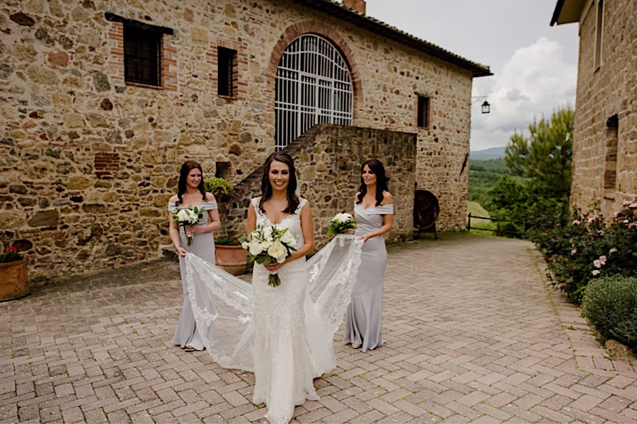 Bride with bridesmaids walking