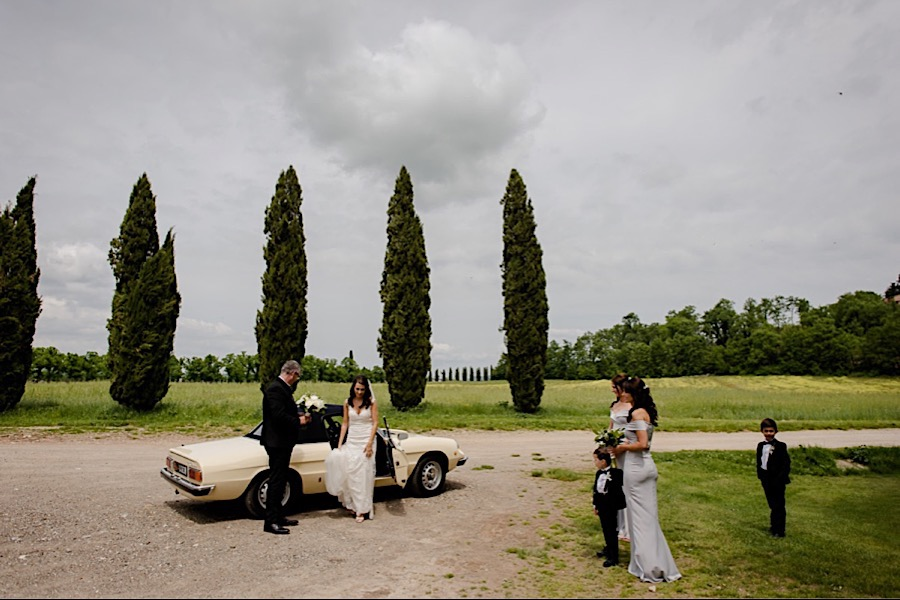Bride arrival with father and bridesmaids at San Galgano abbey