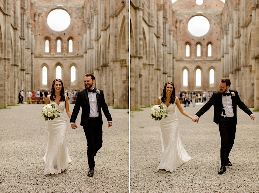 bride and groom walking hand in hand at san galgano abbey