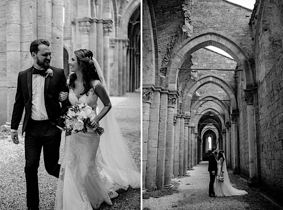 Bride and groom walking together at san galgano abbey black and white