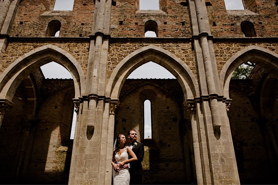 Bride and groom embraced at san galgano abbey