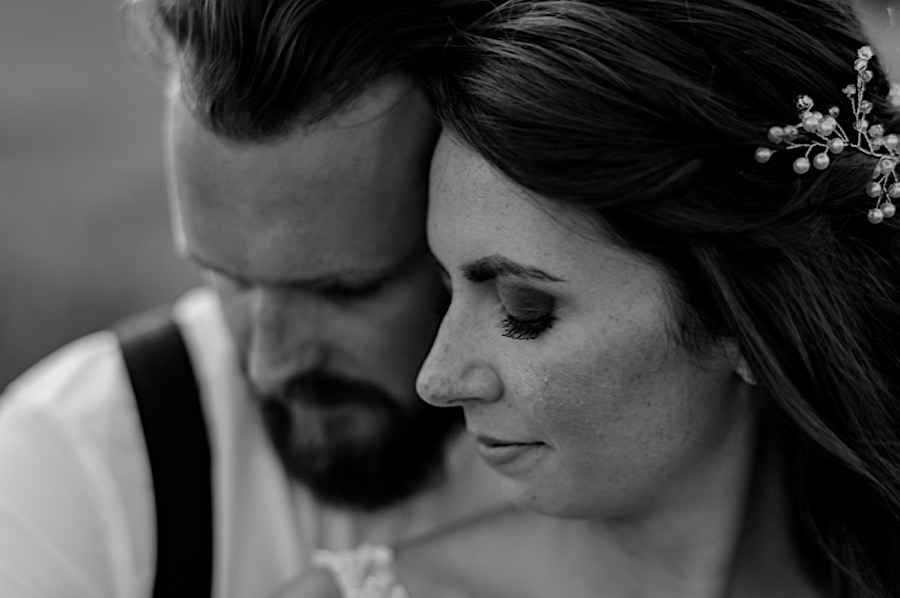 Bride and groom intimate moment black and white