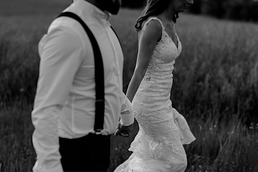 Bride and groom wlaking together black and white