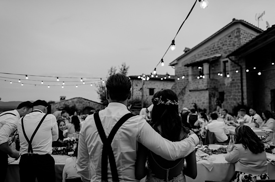Wedding couple embracing each other during the dinner