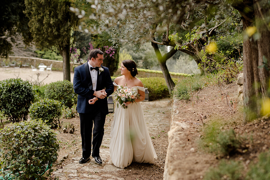 Bride and Groom walking together at Villa Le Fontanelle Florence