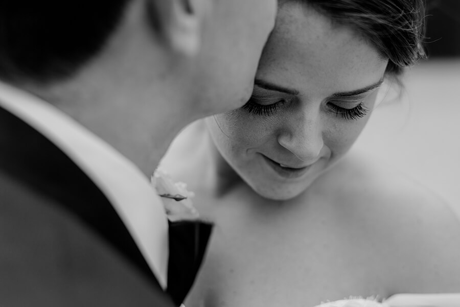 Portrait of the Bride and Groom intimate moment black and white photo