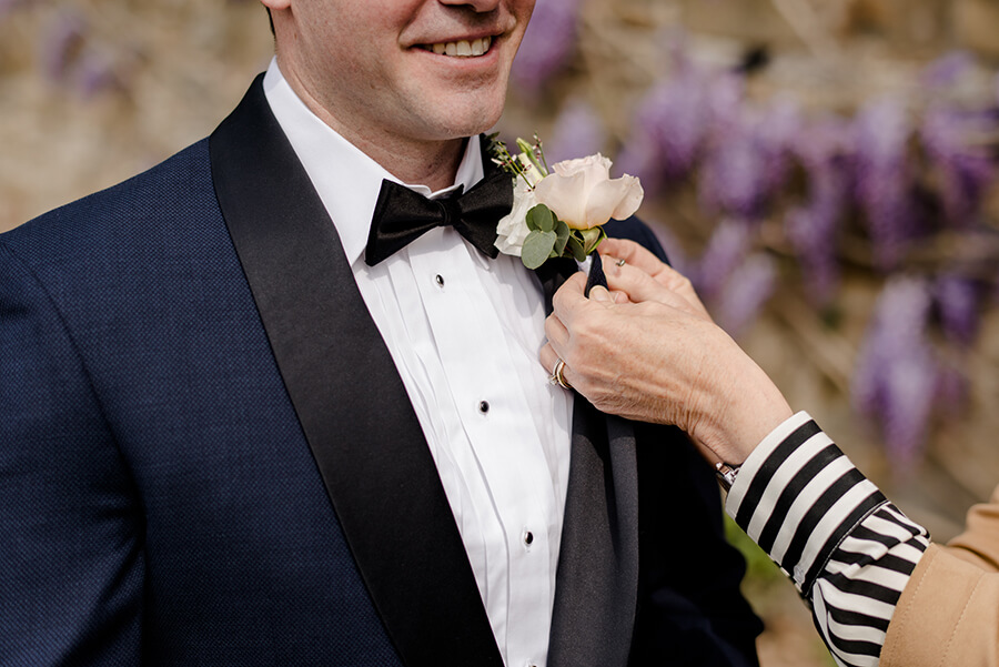 Groom with flowers on his jacket