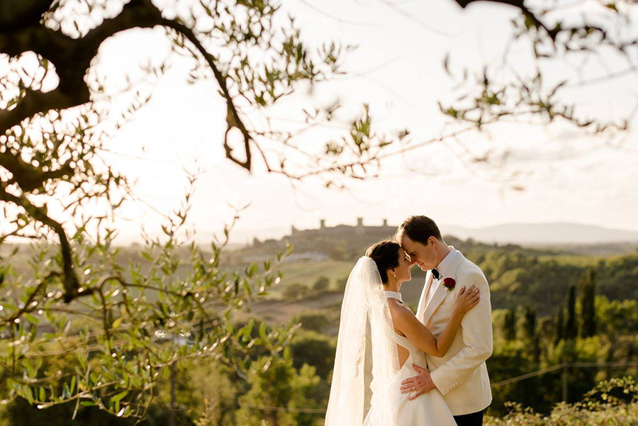a beautiful wedding couple with monterigigoni in the background