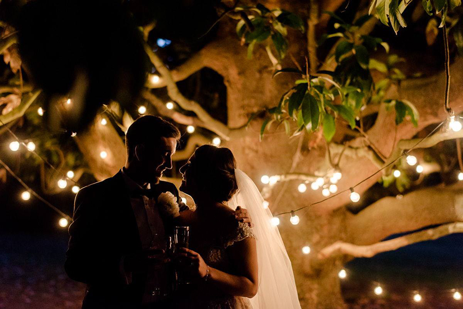 a beautiful couple with the stringlights in tuscany