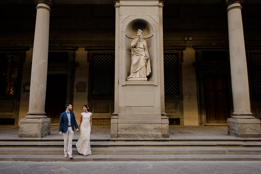 A newlywed couple walking in Florence after they got married