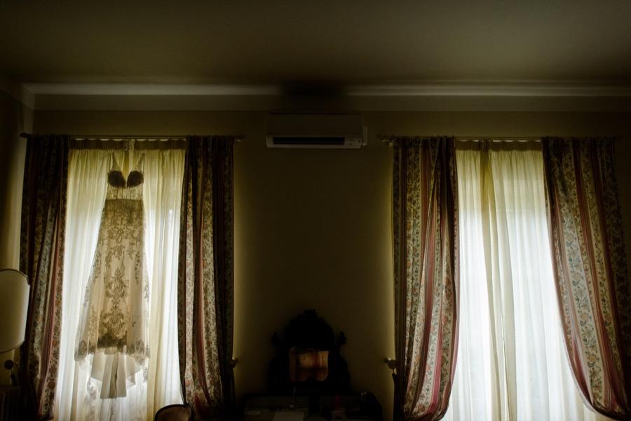 bridal dress hanged at the window