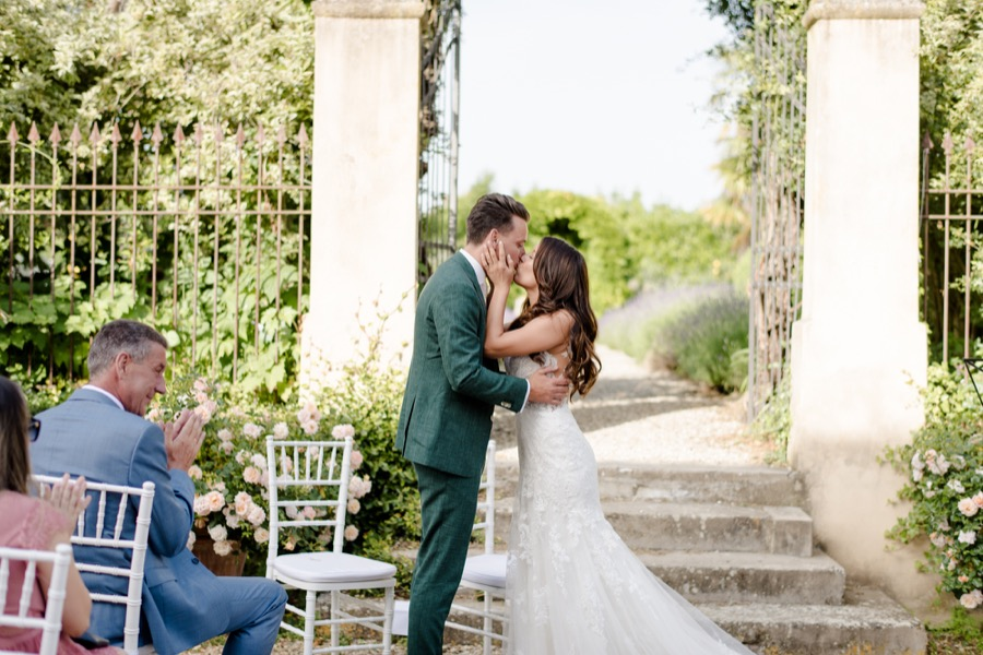 wedding ceremony at Tenuta di Pratello Country Resort bride and groom kissing