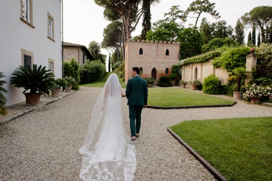 bride and groom walking at Tenuta di Pratello Country Resort