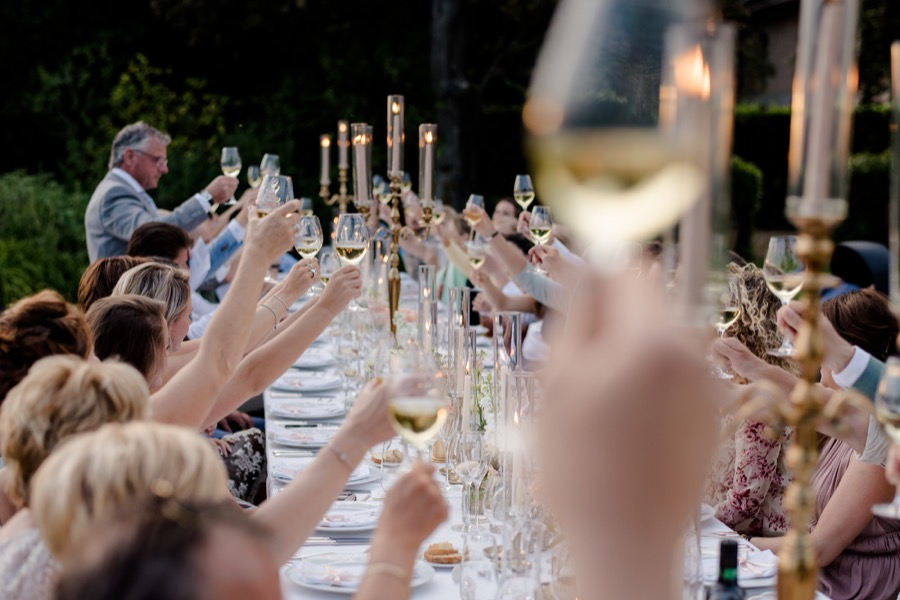 Group toast during a wedding dinner at Tenuta di Pratello Country Resort