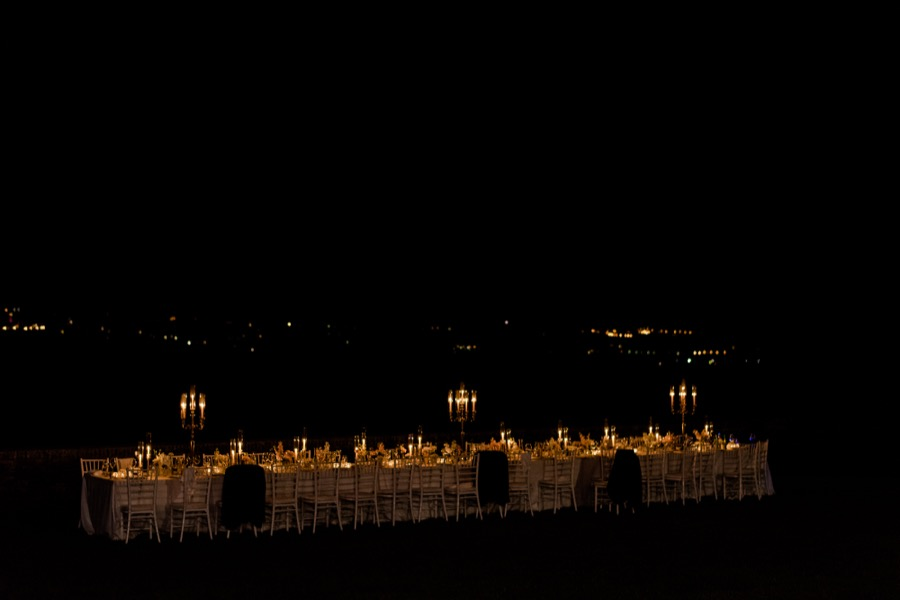 dinner table with candle lighting at night at Tenuta di Pratello Country Resort