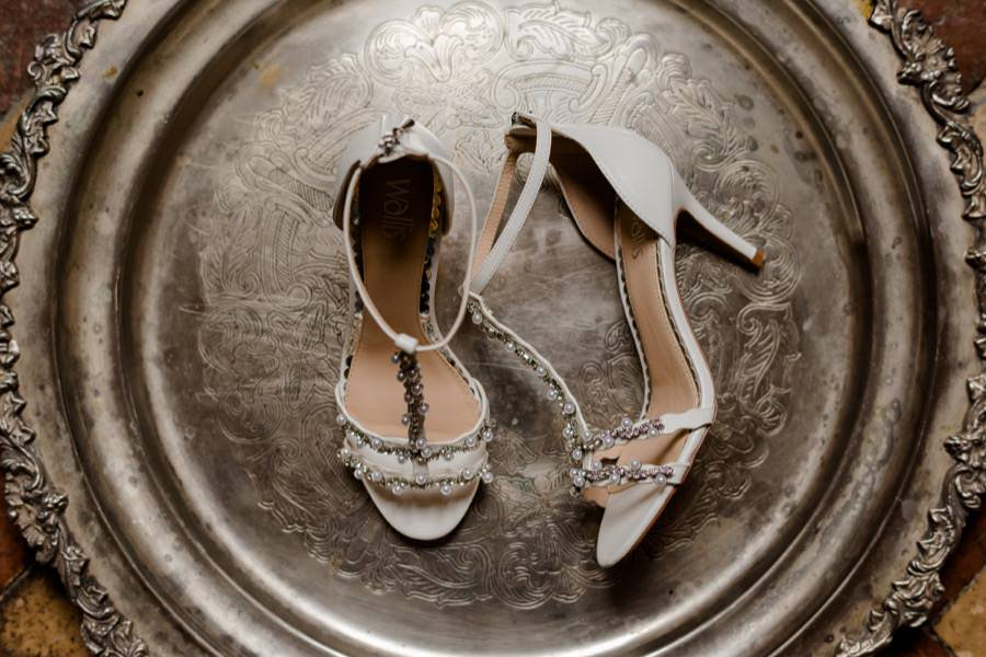 bridal shoes on a silver plate