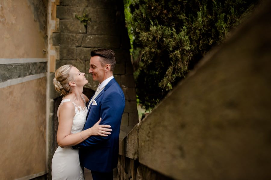 beautiful wedding couple at montegufoni castle