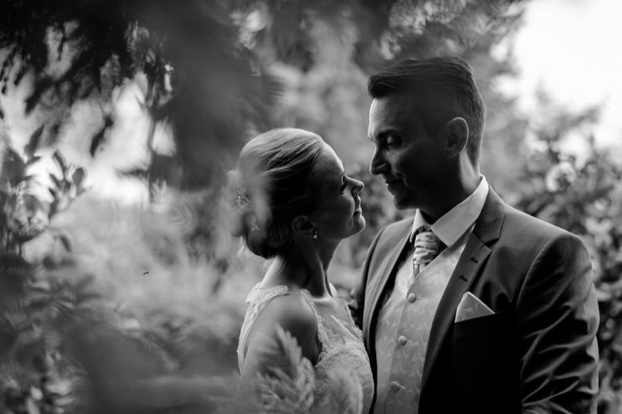 intimate moment bride and groom black and white at montegufoni castle