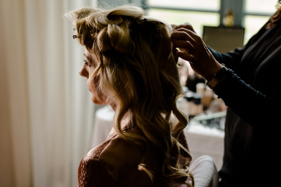 hairdress of the bride during the getting ready