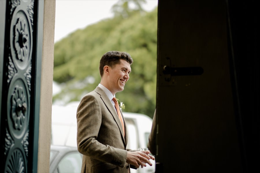 groom smilinkg outside