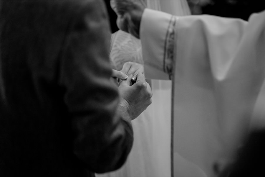 hands details during the exchanging of the rings black and white photo
