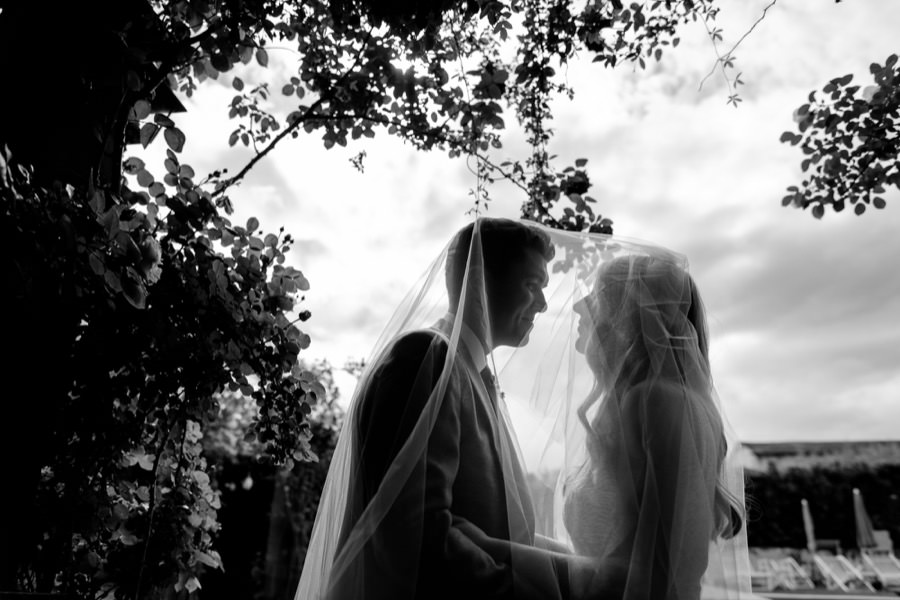 Bride and Groom with sky backlight black and white photo
