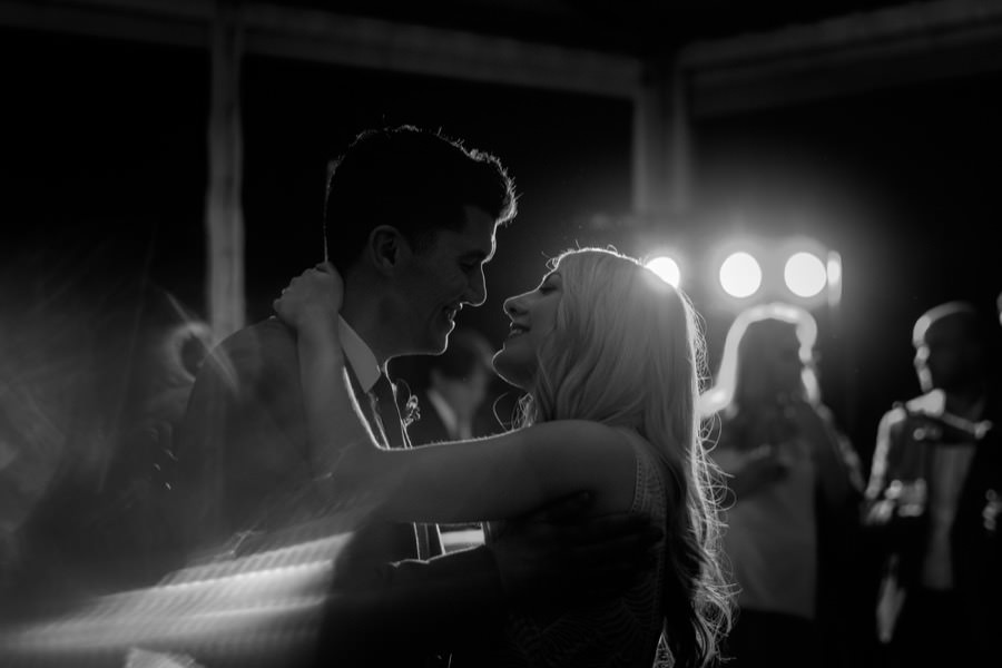 Romantic first dance of bride and groom black and white photo