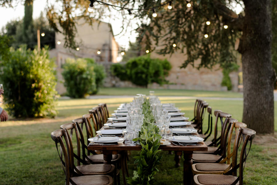 wedding dinner alfresco with greenery