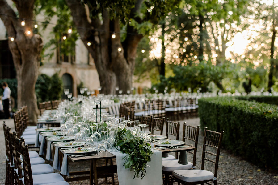 wedding table setup in tuscany with fresh greenery