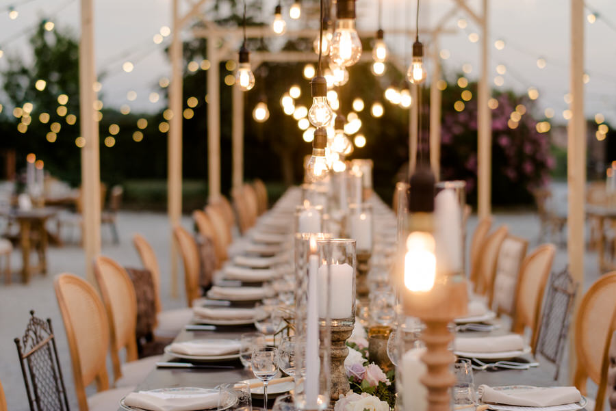 candles and lights for an outdoor wedding table in tuscany