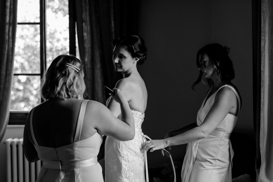 getting ready of the bride black and white photo