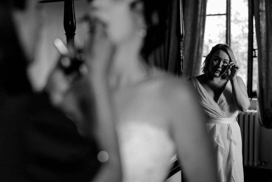 bridesmaid crying candid photo in black and white