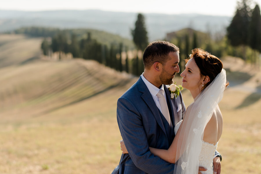 Bride and groom together in the tuscan countryside