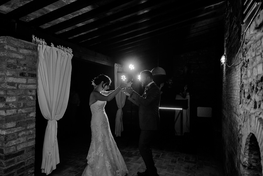 bride and groom first dance black and white photo