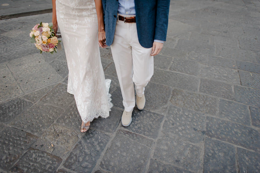 bride and groom walking together in florence