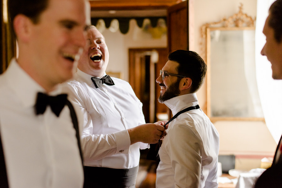 candid moment during the getting ready of the groom at borgo stomennano