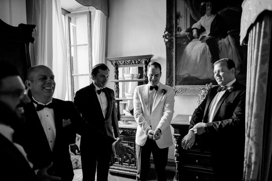 getting ready of the groom with his bestmen black and white