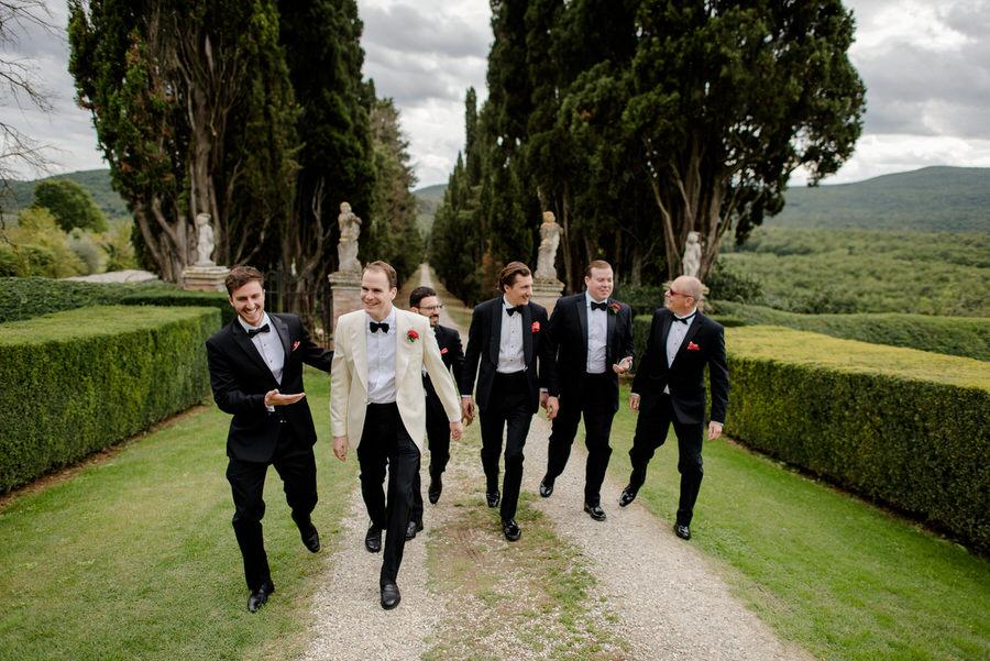 groom squad walking at borgo stomennano