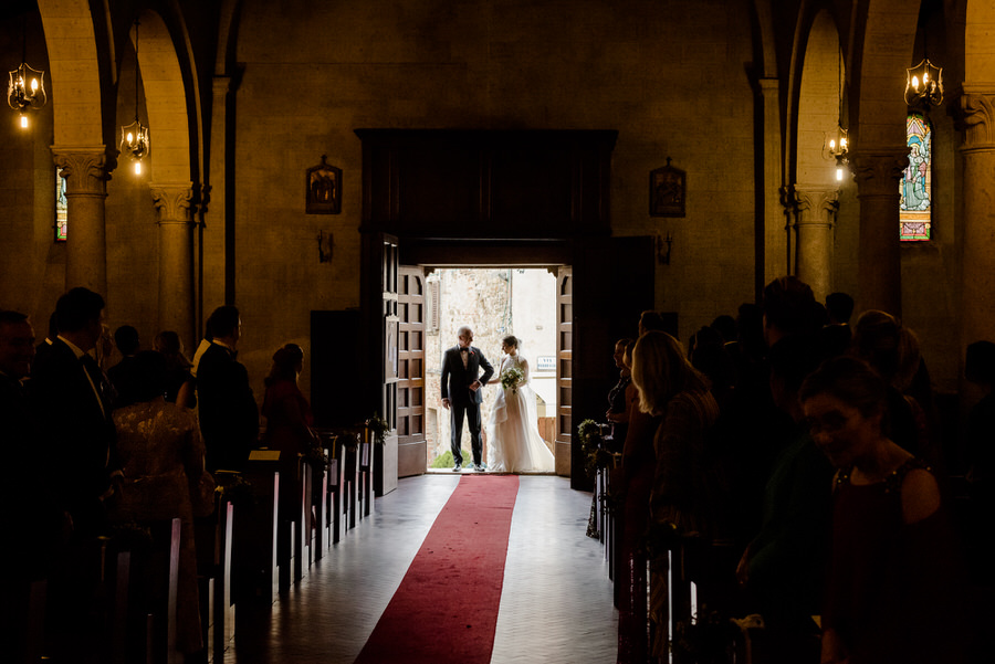 bride with her father entering in the church