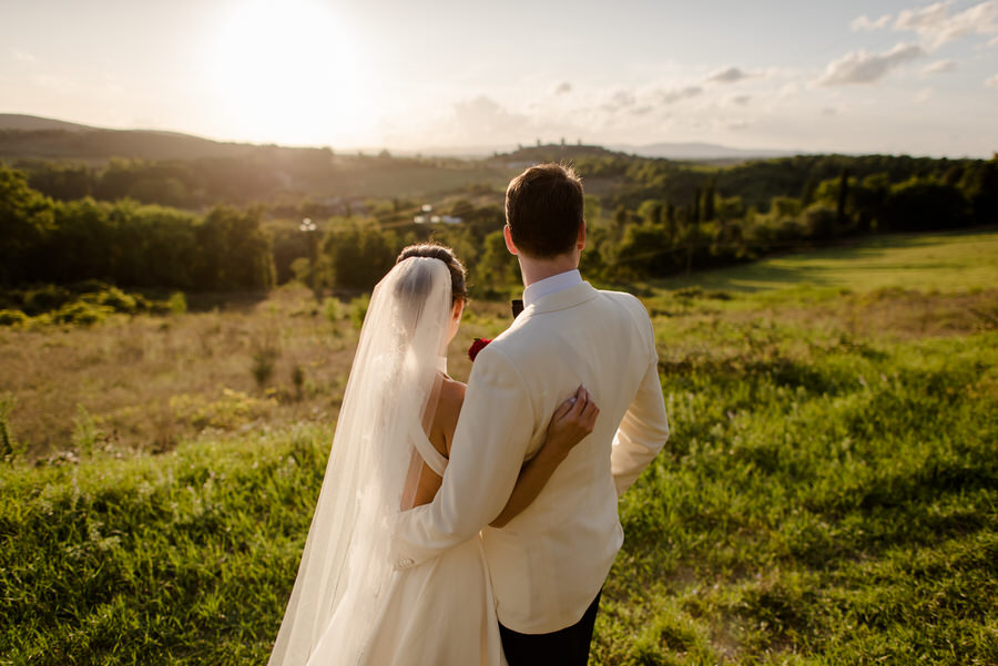 bride and groom portrait from behind with the tuscan landscape