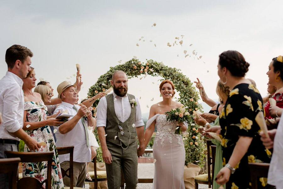 throw of confetti during a wedding ceremony in tuscany