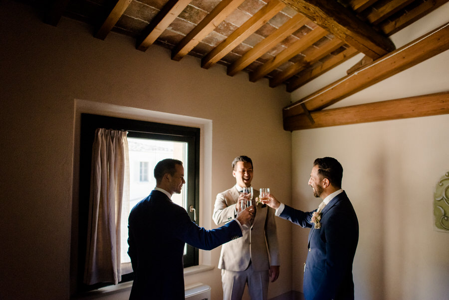 a toast of the groom with the groomsmen