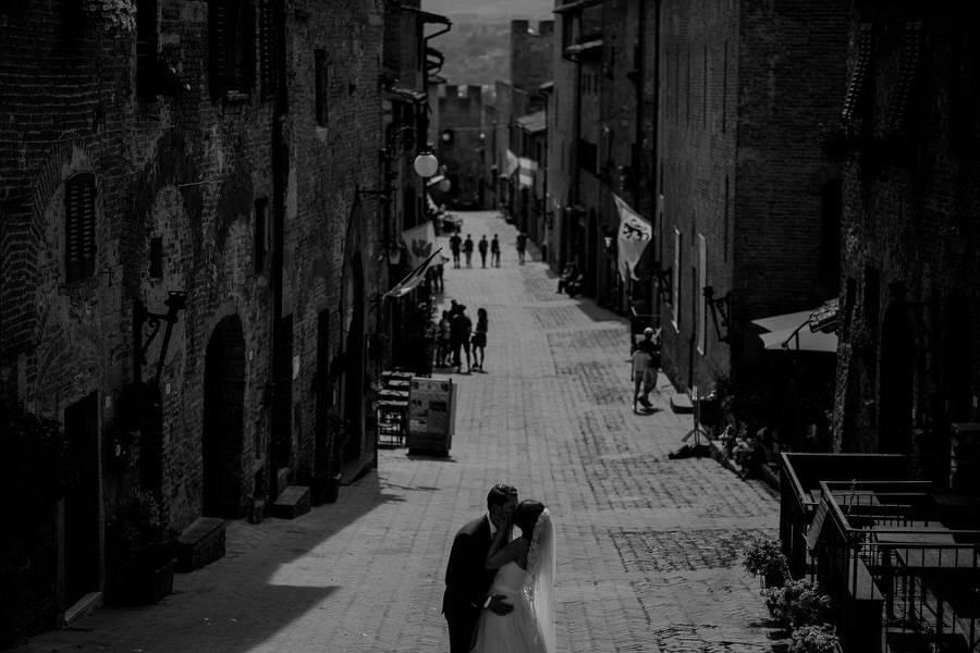 A couple kissing in Certaldo Tuscany