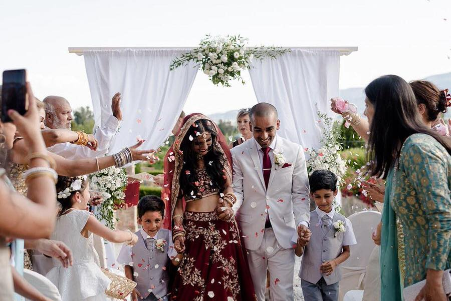 petal toss to Indian wedding couple just married in tuscany