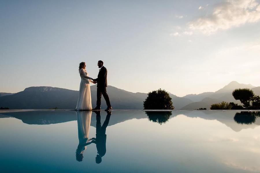 a wedding couple mirrored in the swimming pool in tuscany